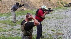 Weapons Instructor Teaches Operators at Gun Range Stock Footage