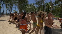 Tourists playing with a ball on the beach, Dominican Republic Stock Footage