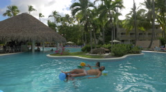 Swimming in the pool at Vista Sol Hotel, Dominican Republic Stock Footage