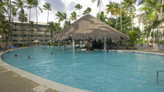 Swimming near the pool bar at Vista Sol Hotel, Dominican Republic Stock Footage