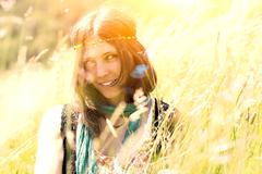 Hippie girl in the meadow in a photograph with vintage artifacts deliberately Stock Photos