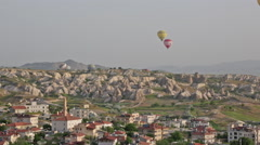 Multi-colored balloons over the settlement of Goreme, Cappadocia Stock Footage