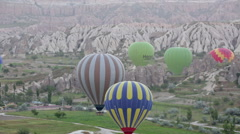Multi-colored balloons fly over rocks, Cappadocia Stock Footage