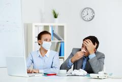 Working during illness - stock photo