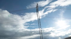 Pan of High Tension Power Lines in Cloudy Background - stock footage
