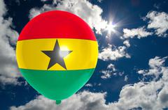 Stock Illustration of balloon with flag of ghana on sky