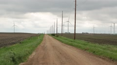 Power Lines Leading From Wind Turbines in Background Stock Footage