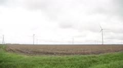 Slow Long Distance Pan Shot of Wind Farm Stock Footage