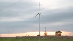 Wind Turbine Slowly Turning on Open Prairie Stock Footage