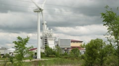 Wind Turbine in Foreground of Modern Buildings Stock Footage