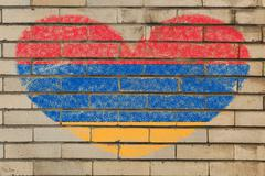 heart shape flag of armenia on brick wall - stock illustration