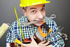 Repairman with tools - stock photo