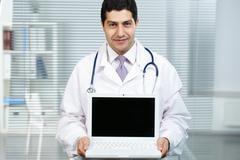 Presenting new method of treatment Stock Photos