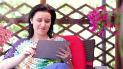Young woman using tablet computer outside - stock footage