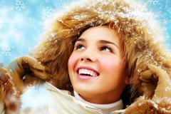 Happy girl in furry hood Stock Photos