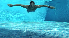 Man swimming under water Stock Footage