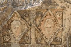 Mask photo from the Greek-Roman amphitheater. Masks and Lycian tombs in the M Stock Photos