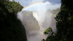 Victoria Falls Zimbabwe Africa Waterfall rainbow Zambezi River Stock Footage