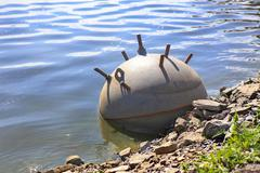 army sea mine on water - stock photo