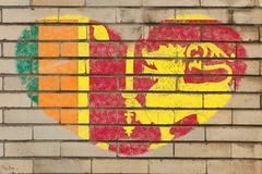 heart shape flag of sri lanka on brick wall - stock illustration