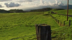 Panoramic shot of farmland, sun glistening with lightrays.  Stock Footage