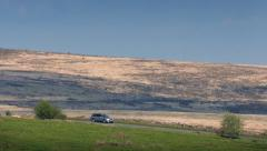 Cars On Hillside On Hot Summer Day Stock Footage