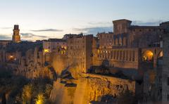 Pitigliano by night, typical village of the italian Tuscany land Stock Photos