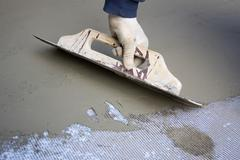 hand of bricklayer at the work - stock photo