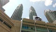Panning Petronas Menara, Twin Towers from KLCC park side, Suria logo Stock Footage