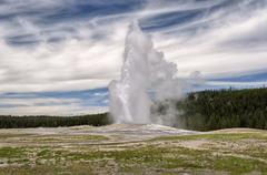 Eruption of Old Faithful geyser at Yellowstone National Park - stock photo