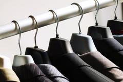 Jackets on hangers Stock Photos