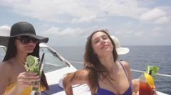 Young Women Friends Enjoy Chilled Drinks On Boat - stock footage
