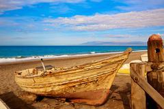 Almeria Cabo de Gata beached boats in the beach - stock photo