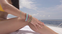 Young Woman Applies Suntan Lotion Stock Footage
