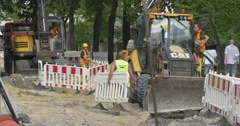 City Day Opole Men Installing Safety Fence Maintenance of Road Excavator Gets Stock Footage