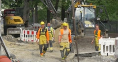 City Day Opole Men Take and Install Safety Fence Excavator is Parked Workers at Stock Footage