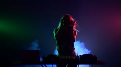 Sexy blonde dj girl flipping hair, touches it, dancing, silhouette, slow motion - stock footage