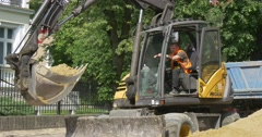 Opole City Day Road Repair Cityscape Excavator Driven by Street Worker in the Stock Footage