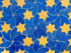 Moroccan mosaic table top background yellow stars on blue Stock Photos