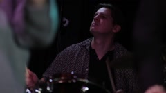 Drummer performing live on stage in night club Stock Footage