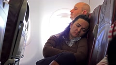 Couple commuters travelling by plane together resting and sleeping. Tourism c Stock Footage