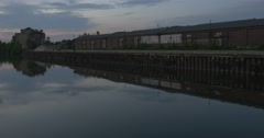 Buildings on The Pier, Reflection in The Water,Sky With Cirrus Gray Clouds, Stock Footage