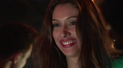 Beautiful girl talking to her friend in night club Stock Footage