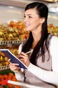 Shopper in supermarket Stock Photos