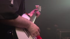 Guitarist rehearsing in night club Stock Footage
