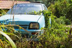 Vehicle abandoned to their fate and overgrown Stock Photos