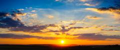 High resolution colorful dramatic sunset panorama - stock photo