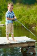 Little fisher - stock photo