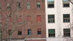 4k Zoom out from appartment closed window. Establishment shot of red brick bu Stock Footage