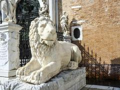 Ancient stone lion statue at the gates of Arsenal, Venice - stock photo